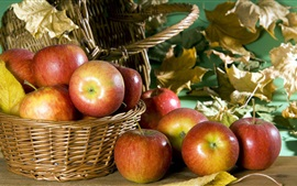 Ripe apples, basket, leaves, autumn