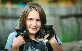 Preview wallpaper Smile girl, two black kittens