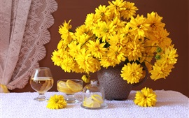 Yellow rudbeckia flowers, vase, cups