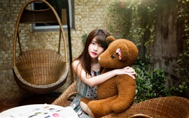 Young Asian girl and toy bear