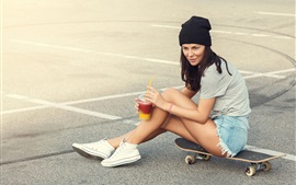 Young girl, shorts, ground, cocktail, skateboard