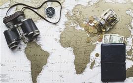 Binoculars, world map, purse, dollars