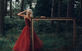 Preview wallpaper Blonde girl, red skirt, photo frame, forest