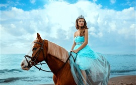 Blue skirt girl riding horse, sea, sky, clouds