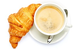 Croissant, coffee, white background