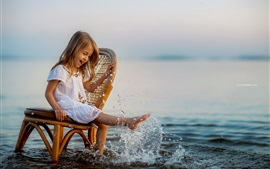 Preview wallpaper Cute little girl sit on chair to play water