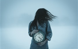 Girl and clock, wind, hair flying