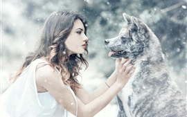 Preview wallpaper Girl and dog face to face, friends, snow