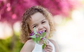 Preview wallpaper Happy curls little girl, lilac flowers