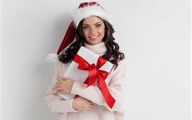 Preview wallpaper Happy girl, gift, sweater, Christmas hat