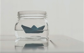 Paper boat, glass bottle