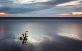 Sea, clouds, sunset, child toy bike