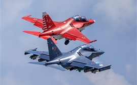 Preview wallpaper Two Yak-130 light attack fighters flight