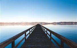 Wooden bridge, lake, people, mountains