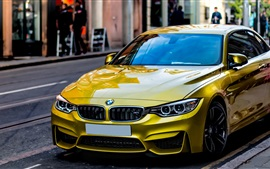 Preview wallpaper Yellow BMW car stopped at street side