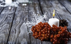 Berries, white candle, flame