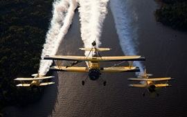 Preview wallpaper Biplanes, aircraft, flight show, river, smoke