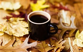 Black cup coffee, maple leaves