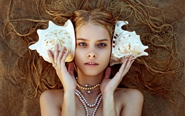 Blonde girl, seashell