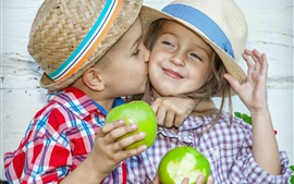 Preview wallpaper Child, little girl and little boy, kiss, eat green apples