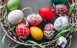 Colorful Easter eggs, twigs, holiday