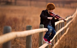 Preview wallpaper Cute child boy play violin