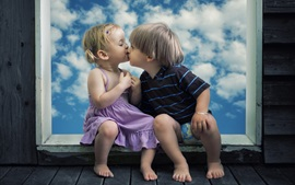 Cute child girl and boy, kiss, window, clouds