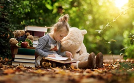Preview wallpaper Cute child girl reading book, toy bear