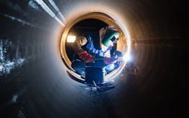 Preview wallpaper Electric arc welding, glare, helmet, worker, pipe