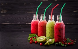 Four bottles of fruit juice, kiwi, berries