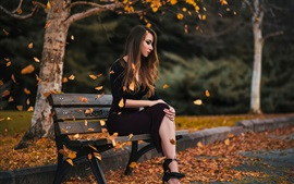 Girl sit on bench, park, leaves, autumn