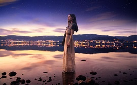 Girl standing in water, lake, city, starry, dusk