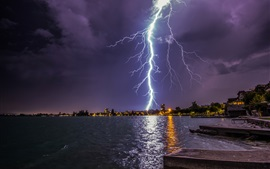Preview wallpaper Lightning, storm, city, lake, lights, night, pier