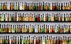 Many bottles, shelves, drinks
