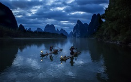 Mountains, river, boats, fisherman