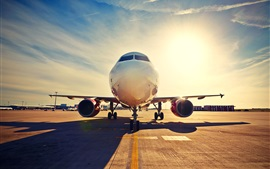 Preview wallpaper Passenger plane, front view, airport, runway, sunset