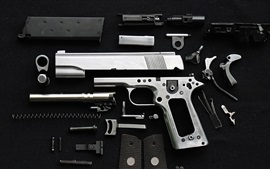 Preview wallpaper Pistol disassembled metal parts, weapon