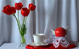 Red tulips, tea, cup