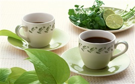 Preview wallpaper Two cups of tea, lime, green leaves