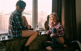 Preview wallpaper Two girls sit on windowsill