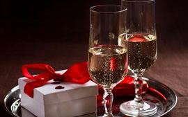Two glass cups of champagne, gift, romance