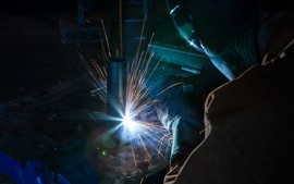 Welder, sparks, glare, worker