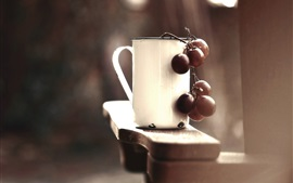 White cup, grapes