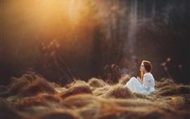 White skirt girl sit on grass, forest
