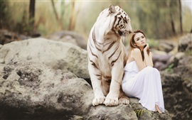Preview wallpaper White tiger and Asian girl, sitting on stone, friendship