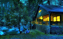 Preview wallpaper Wooden house, lights, river, trees, dusk