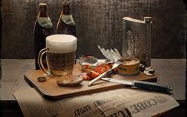 Cerveza, pescado, periódico