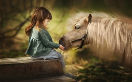 Cute little girl and horse, mane