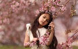 Cute little girl, pink cherry flowers
