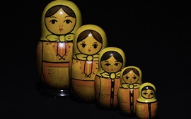 Muñecas, niña, fondo negro